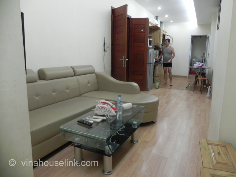 The livingroom is on the right from the entrance  It is with basic furniture. A reasonable 2 bedroom serviced apartment for rent in Le Duan